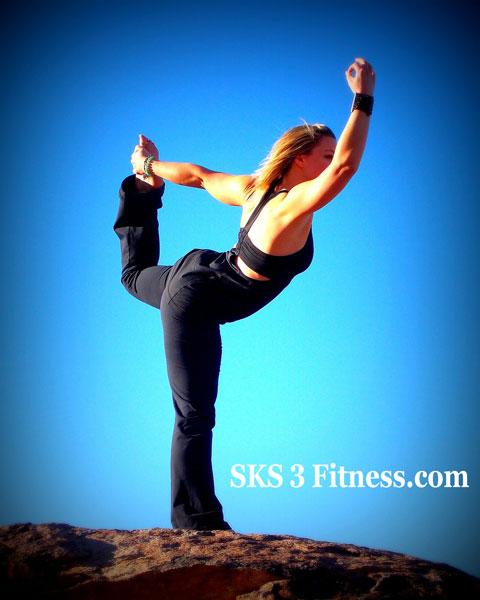 Women doing Dancer Pose on the hill