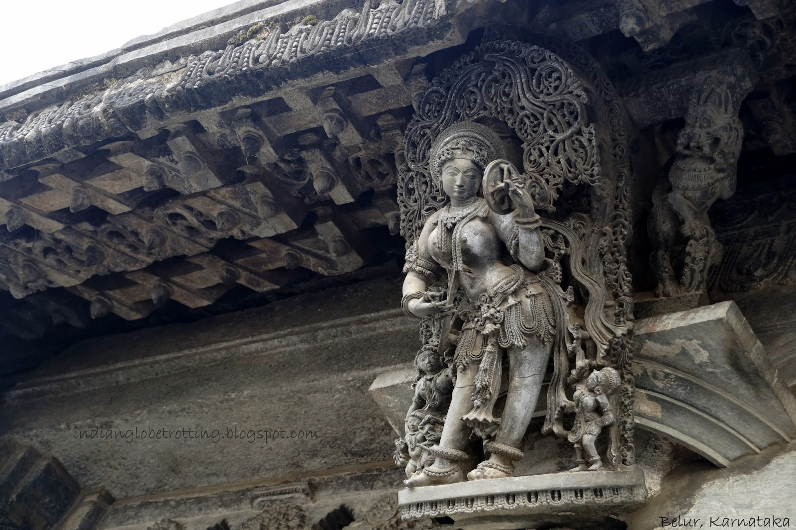 lady with mirror statue in belur