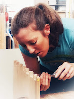 Image of a woman using a chisel to make a dovetail jonit