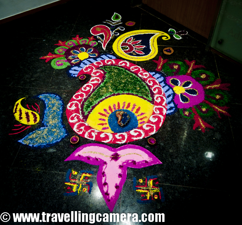 Diwali Rangoli,Art at Adobe, Rangoli is a traditional decorative folk art of India. These are decorative designs made on floors of living rooms and courtyards during Hindu festivals and are meant as sacred welcoming areas for the Hindu deities. The ancient symbols have been passed on through the ages, from each generation to the one that followed, thus keeping both the art form and the tradition alive. Rangoli and similar practices are followed in different Indian states; in Tamil Nadu, one has Kolam, Madanae in Rajasthan, Chowkpurna in Northern India, Alpana in Bengal, Aripana in Bihar, and so on. The purpose of Rangoli is decoration and it is thought to bring good luck. Teams make rangolis every year before Diwali at Adobe. However, this time the patterns were incredibly intricate and imaginative.Om is the sacred symbol of Hinduism, Buddhism, and Jainism and can often be seen in religious arts. Rangoli is no exception.The traditional rending of a new bride in a Doli. In medieval and ancient India and for a long time even in modern India, after marriage, dolis bourne on the shoulders of 4-6 men were used to transport the new bride to her husband's home. Marigold flowers (गेन्दा) are inseparable from Hindu Prayers and religios decorations. Idols of Deities are often adorned with garlands of marigold flowers and red roses.This is a clever integration of a peacock in the face of Lord Ganesh. While the peacock is the greatly revered in Hindu Scriptures, Lord Ganesh is the deity who the Hindus rely upon to take care of new entreprises. Beautiful colors and image! The peacock is also the National Bird of India.A pattern with the peacock in the center and outlined with marigold and rose petals.A Peacock is often referred to as a bird with a hundred eyes owing to the eye-like patterns in its tail feathers. The Kalash (a brass pot) is a symbol of abundance in Hinduism. It is often worshipped during the yagyas along with the deities in Arya Samaj branch of Hinduism. Full rendering of a peacock on the branch of a flowering plant with symbols of various Adobe Products in its tail. It is holding a scroll with the symbol of Adobe and the Sacred Swastik in its beak. Swastik, contrary to common knowledge, is an ancient holy symbol in Hinduism. Unfortunately, it was used by Nazis and after that the real, holy meaning seems to have been lost to the world. But in India, it is still used with a lot of respect in almost all religious ceremonies.  Lord Ganesh with his elephant head and human body. Lord Ganesh is widely worshipped along with Goddess Lakshmi (the Godess of Wealth) during diwali. Lord Ganesh, himself, is considered to be the God of New Beginnings, someone who removes hurdles. Another colorful design with the logos of various Adobe products, You can see the well know photoshop, Premiere Pro, Dreamweaver, Acrobat, InDesign etc.Diya's (earthen lamps) are used during diwali to decorate houses and businesses. They are shallow vessels made of clay or brass and have a cotton wick dipped in mustar oil.This design is more traditional with Om and a stark white color against a bright red. Two peacocks with their royal blue necks and bright green plumage. Peacocks seemed to rule the designs this year. A new age Ganesh with his vehicle, a mouse. If you look closely, the mouse if offering him an Apple that looks strikingly similar to the logo of the Software Giant of the same name. While the word Adobe has been written in a calligraphic script at the top. Cheeky!A close-up of the Kalash. This one is earthern but has been paited over with a metallic paint. Around it are typical colors of Hinduism, saffron and yellow. A close-up of the calligraphic Adobe.  Baby Ganesh, floating on a cloud, over a colorful carpet of Adobe Products. Whether this cloud is a spiritual cloud or the technical cloud, is open to interpretations. Another colorful and elaborate design with Ganesh and Swastik, The shape of a mango is another common shape in Indian arts. You'll find it used in abundance in mehndis (henna tattoos) and rangolis.Photoshop, flash, Dreamweaver, Bridge and other Adobe products around an Adobe symbol. A fancy earthen Diya full of blue rangoli color.Lord Ganesh, in his various forms, has inspired many artists. And as a result, his form has been used extensively in all kinds of arts, starting from Rangoli to paintings to sculpting. Simple, yet pretty.Adobe employees admiring one of the rangolis. Elephant, another symbol of Hinduism. This one's a tusker and is carrying Adobe on its back. Elephants are closely related to Lord Ganesh. The Rangolis are as colorful as Adobe itself. This particular Rangoli is of a dancing Lord Ganesh.Happy Diwali,  Rangoli, Art,  hinduism, Ganesh, Om, Religion, Art, Colorful