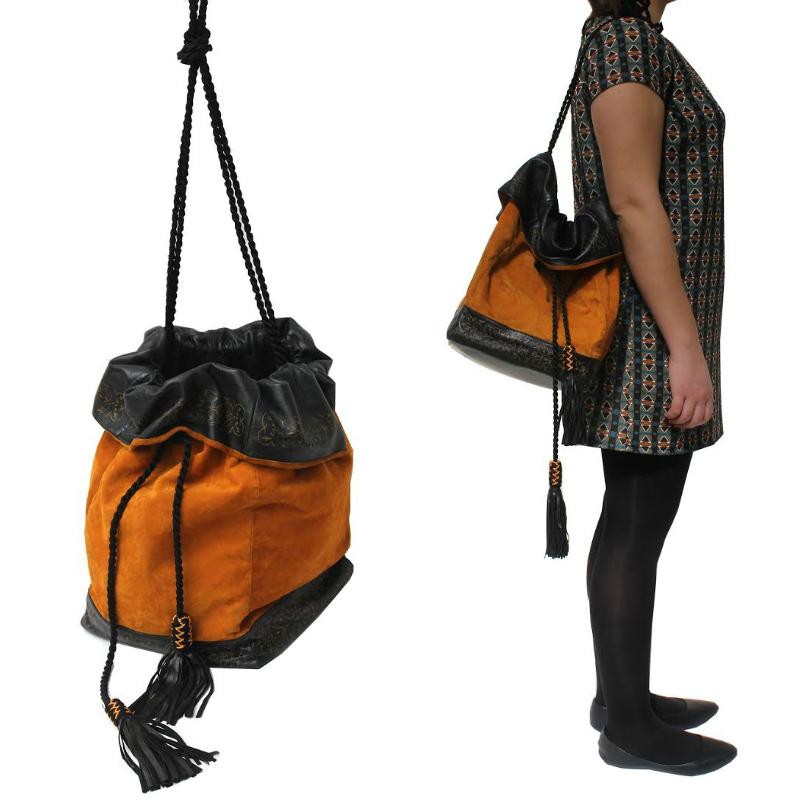 storedandadored designer bag blog: vintage suede bucket bag with laser cut leather