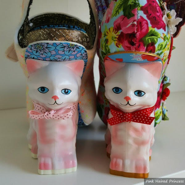 pussy cat heels facing outwards side by side old versus new