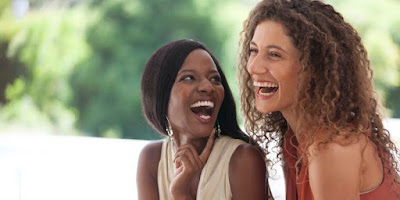 two-black-women-friends-laughing-outdoor