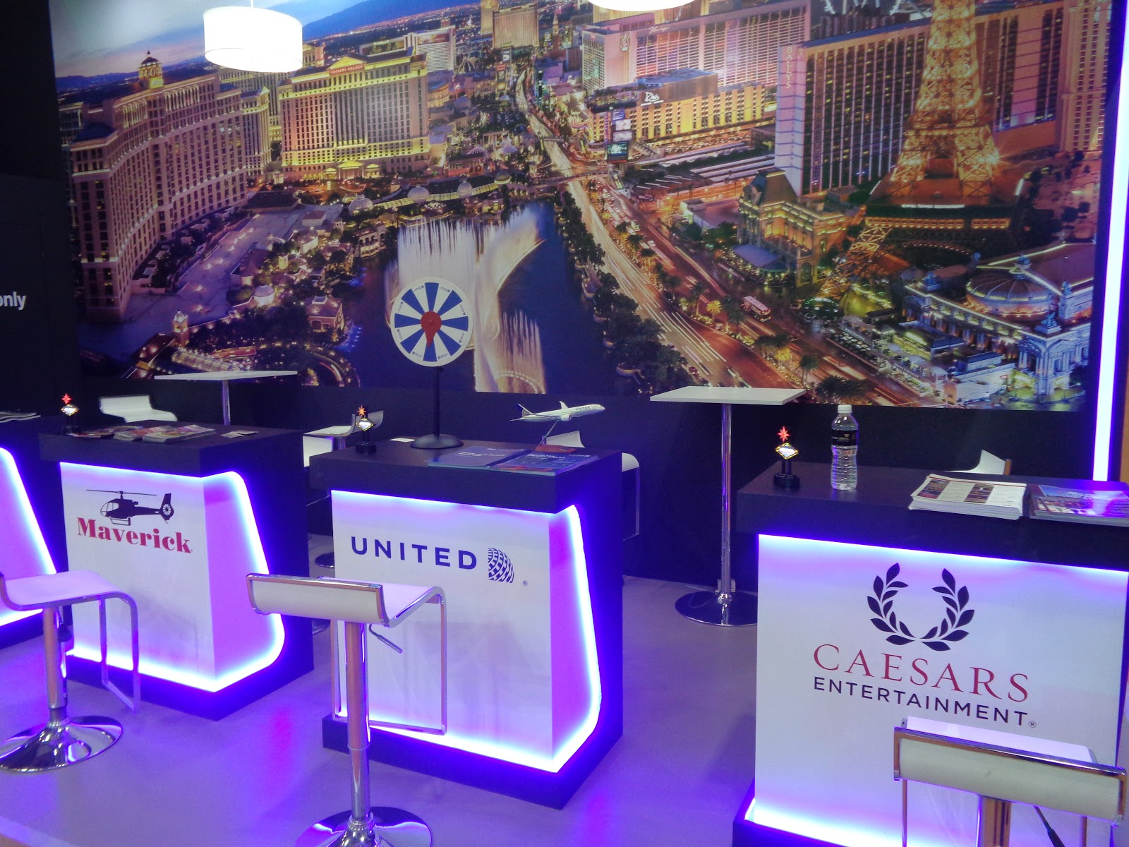 united airlines represented by its singapore branch at the usa pavilion distributes local flight schedules highlighting the two daily flights from singapore