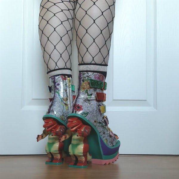 back view of dinosaur heeled boots and fishnet tights