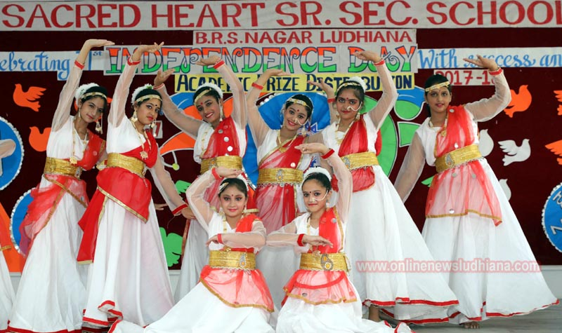 Students perform on stage during annual Academic Prize Distribution Function at Sacred Heart School
