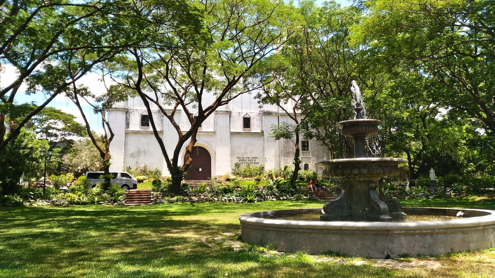 In front of the church and at the lake inside De La Salle University – Dasmarinas | Angelo The Explorer