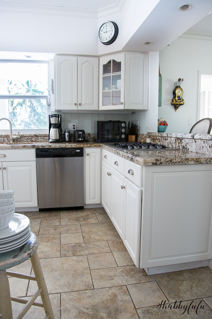 white kitchen with granite counter