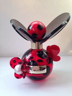 A bottle of Marc Jacobs perfume