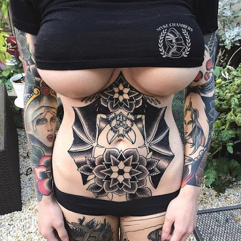 10 Bold Stomach and Sternum Bat Tattoos