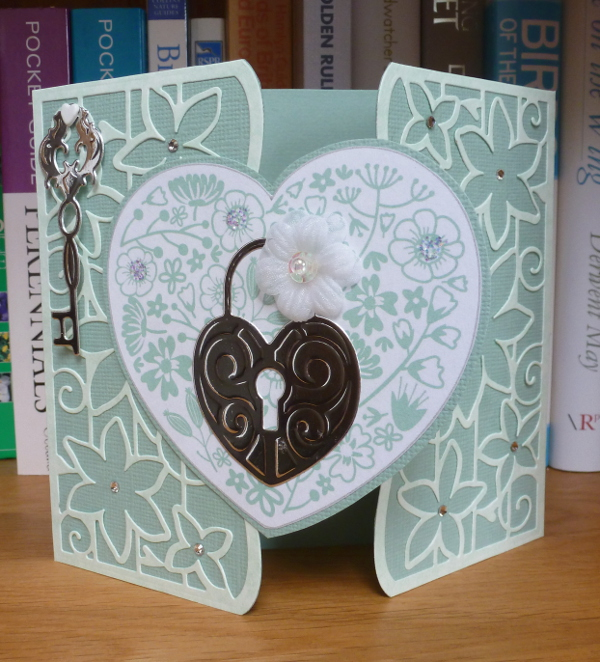 Pale green gatefold card made with Tonic dies heart topper key and lock