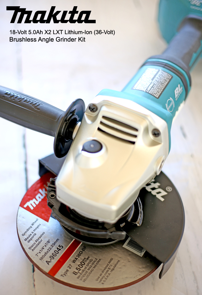 makita angle grinder with grinding wheel.