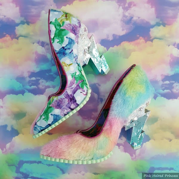 pair of shoes showing one unicorn side and one fluffy side with lightning bolt heels on dreamy cloud background