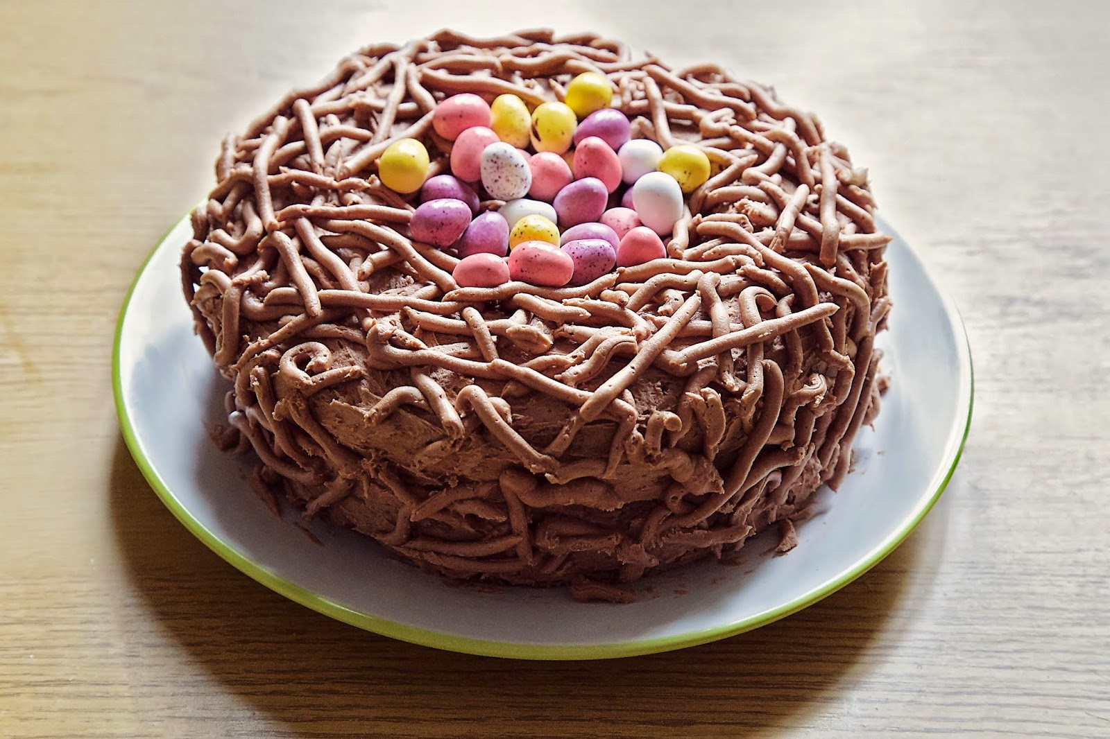Front View of the Easter nest cake with mini eggs in the centre.