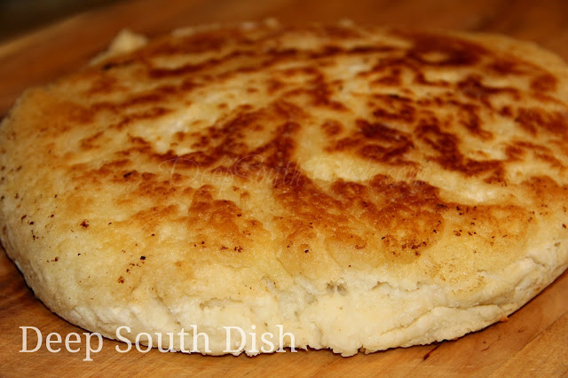 A quick biscuit bread, sometimes called hoecake bread, fried in bacon drippings in a screaming hot, cast iron skillet on top of the stove.