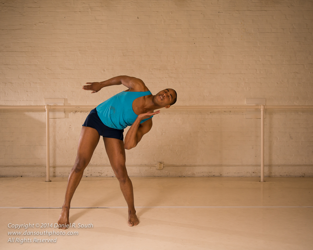 a photo of a modern dancer in his rehearsal studio
