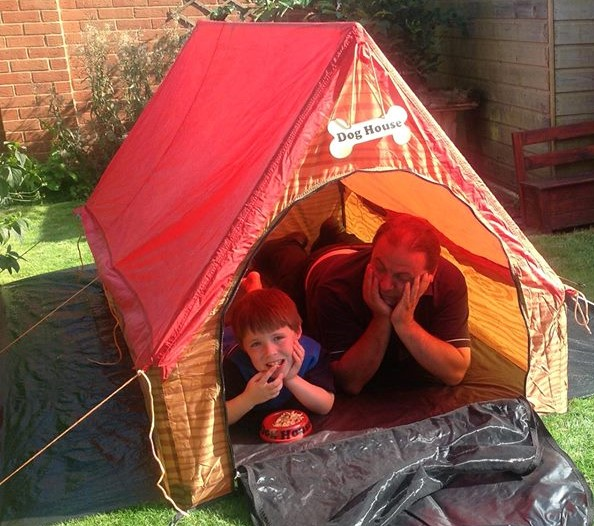 Father and Son in Doghouse Tent