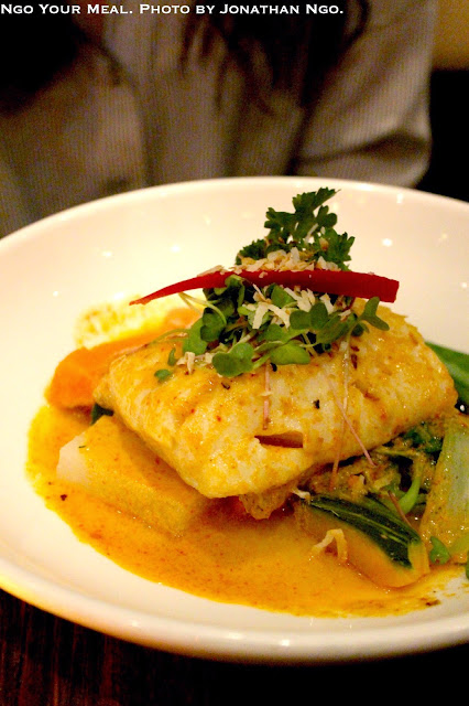 Cod Shu Shee: Pan Roasted Fillet of Alaskan Cod with Thai Curry, Bell Peppers, Kale, Kaffir Lime Leaves Topped with Coconut Milk at Up Thai.