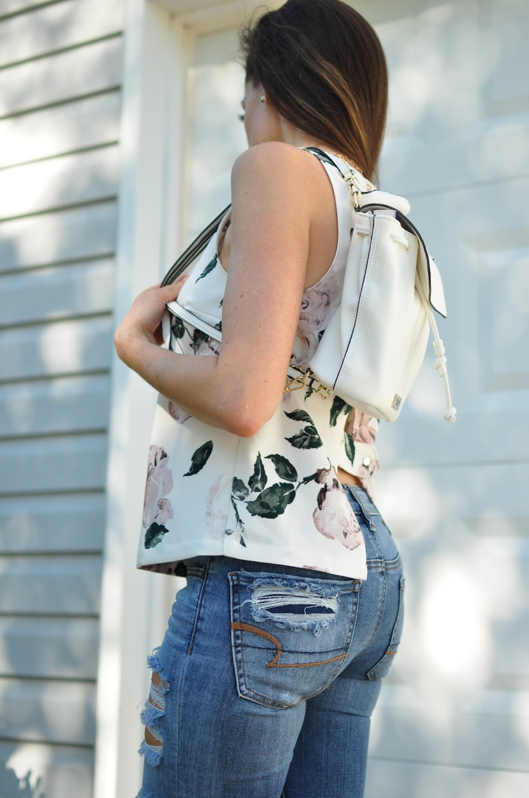 Erica Valentin modeling the Floral Open Back Top from Dynamite Clothing