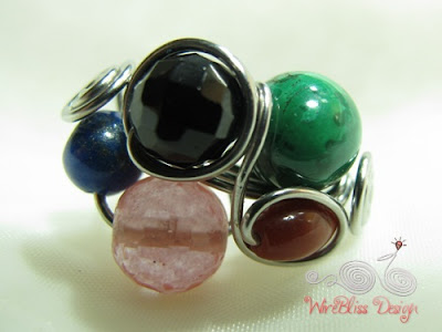 Wire wrap fruity ring with mixture of gemstones