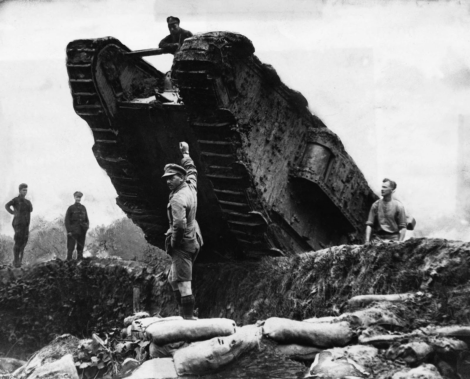 Members of the Royal Navy maneuver a tank, or