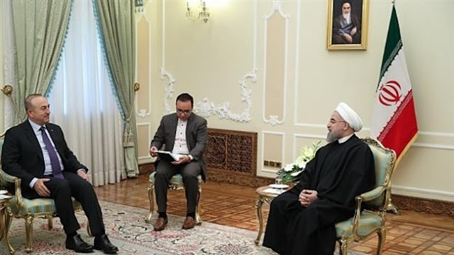 Turkey's Foreign Minister Mevlut Cavusoglu travels to Iran, meets with President Rouhani