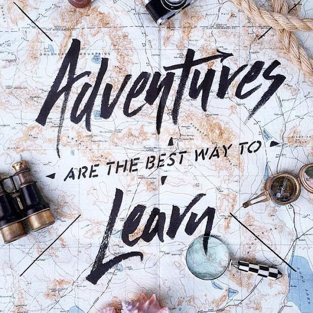 "Travel quote ""Adventures are the best way to learn"" on a map background"