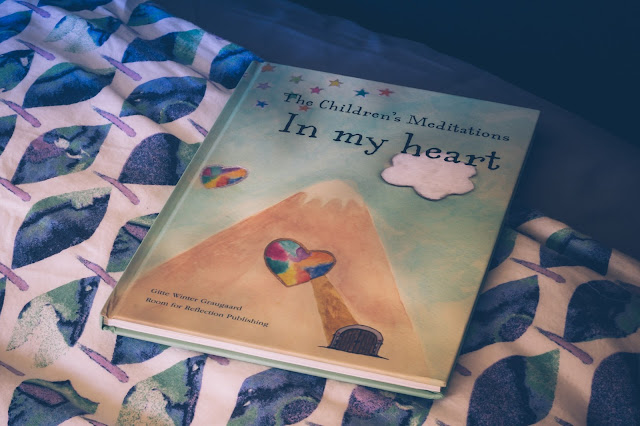 The Children's Meditations In My Heart book on a bed