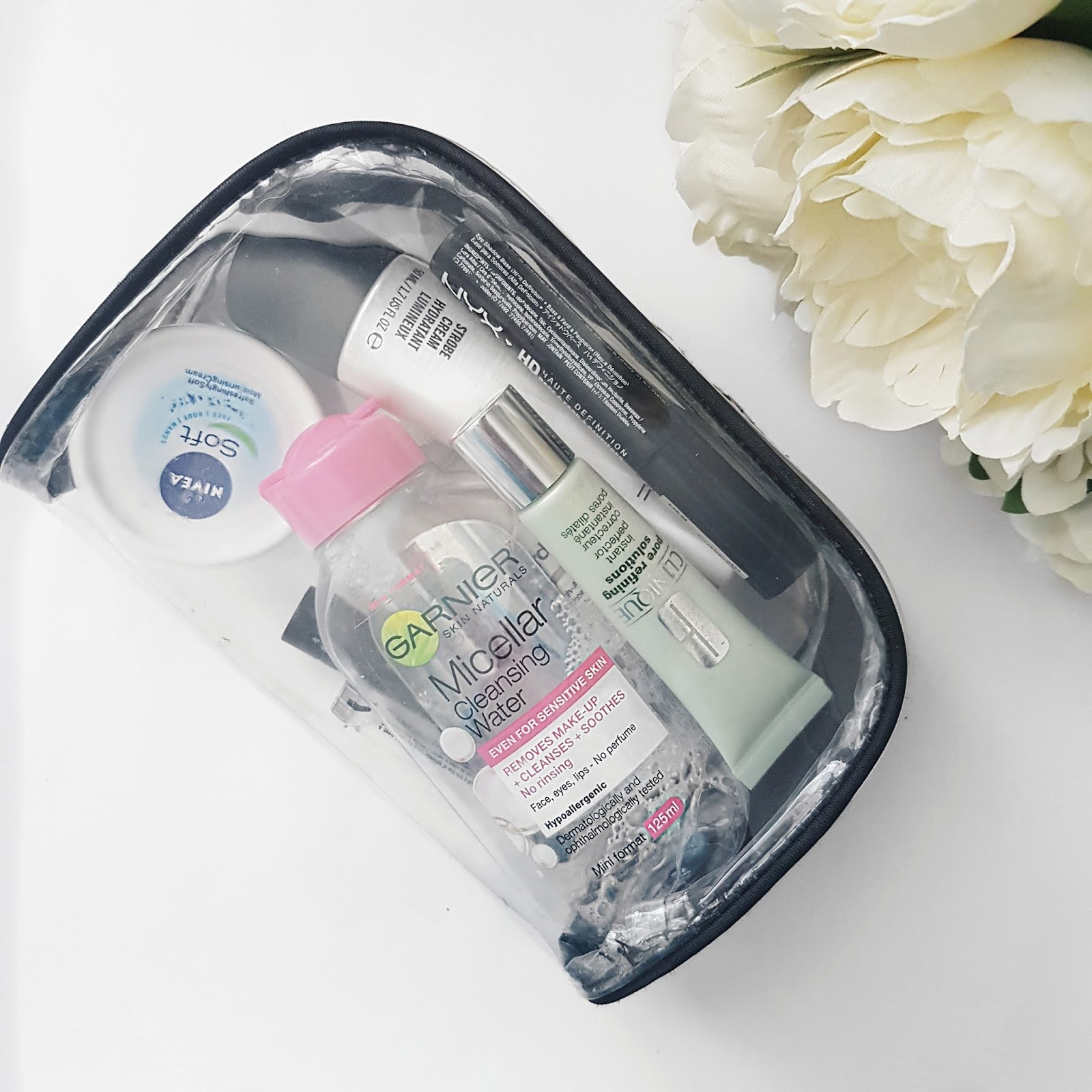 Clear make up bag with skincare inside