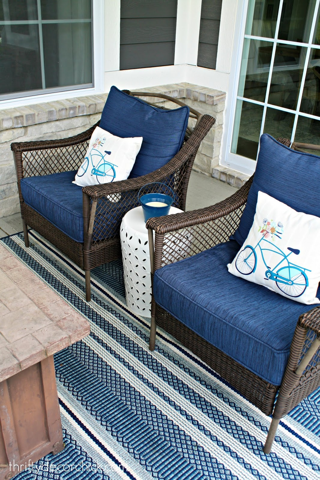 Blue, white and aqua outdoor decor on covered patio