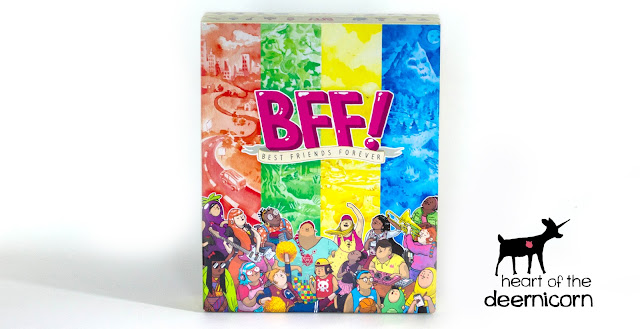The box for BFF! and the heart of the deernicorn logo. The box is colored orange, green, yellow, and blue and has a cast of diverse characters on the cover.
