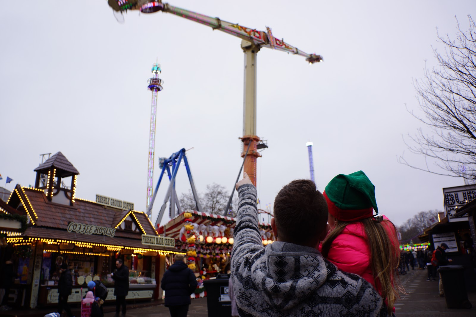 dad and daughter looking at rides at london winter wonderland