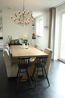 Contemporary Dining Room Design with Wooden Table and Simple Upholstered Dining Chairs under the Wide Chandelier