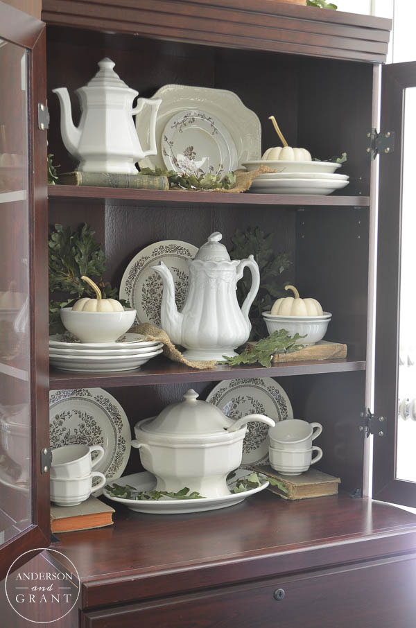 Learn how to create a beautiful display for fall using a hutch full of ironstone.  |  anderson + grant