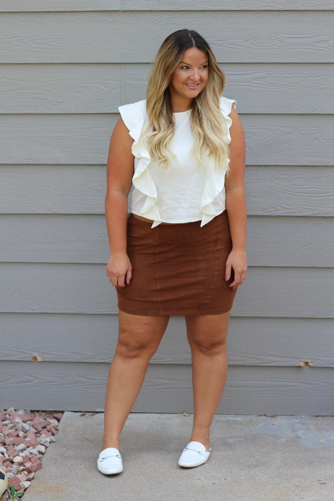 How to style suede skirts featured by top Denver fashion blogger, Delayna Denaye: image of a woman wearing an Express suede skirt, Nordstrom Ruffle top and Target loafer mules