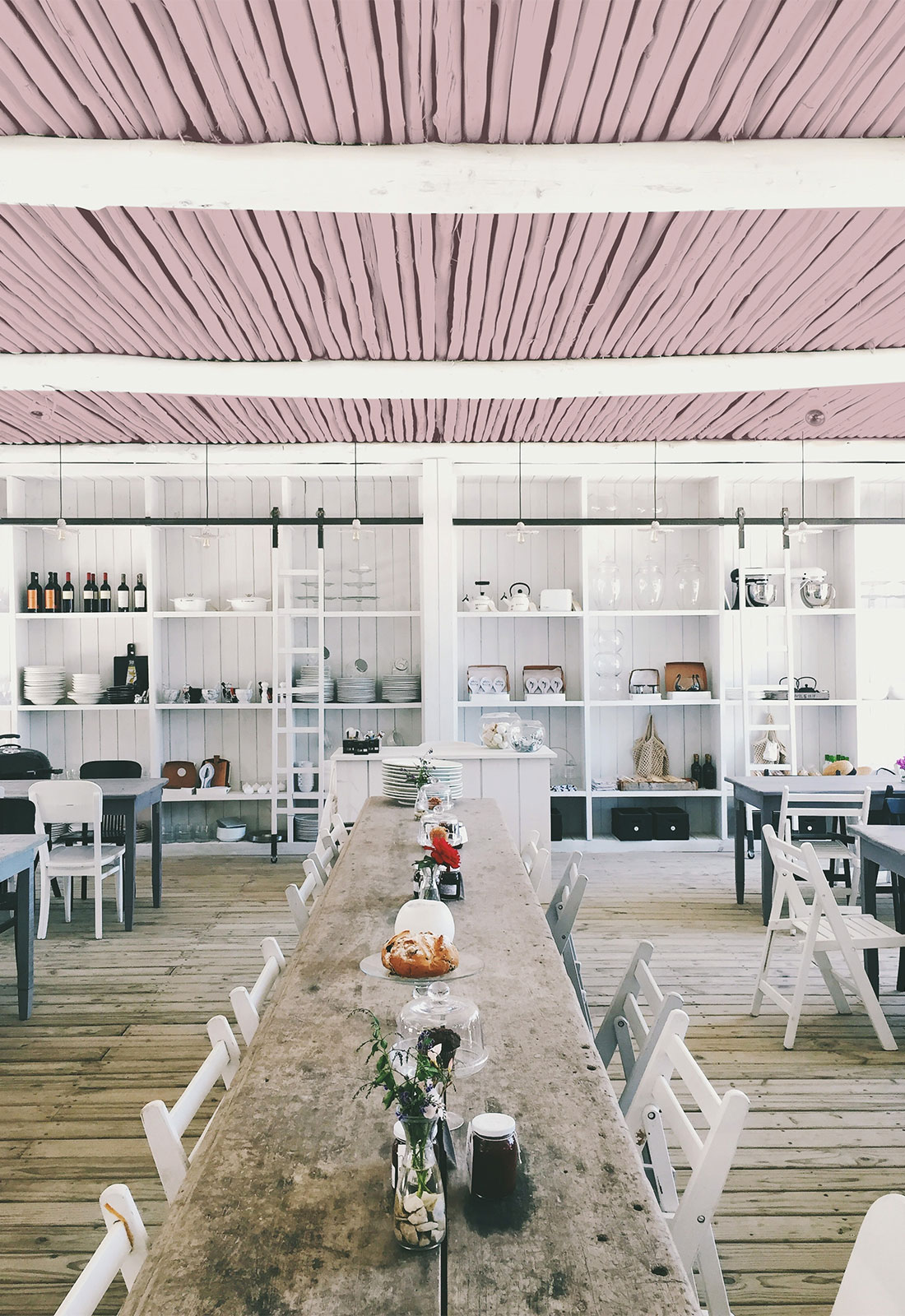 rustic dining space with white walls and blush accents