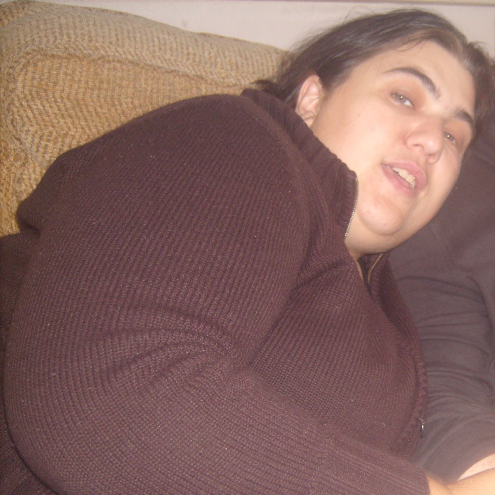 Jen in a brown cardigan morbidly obese showing sideways on just face and arm