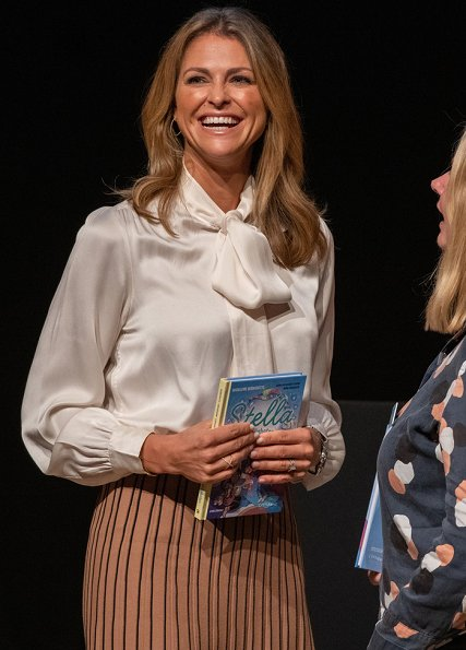 Princess Madeleine wore Dagmar Sabina pleated midi skirt. Princess at the launch of her book Stella and the Secret