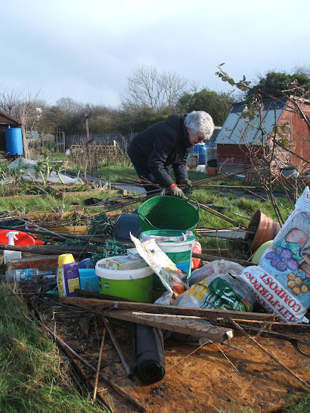 clearing up on our allotment after storm imogen flattens our shed