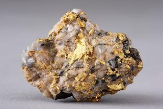 ouro nativo em quartzo - Geologia do ouro, indicadores naturais de ouro