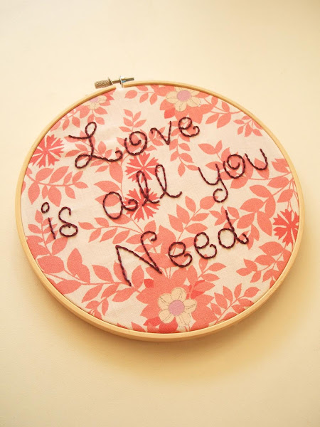 hand embroidered hoop featuring The Beatles love is all you need song lyrics on vintage fabric