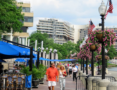 People walking and dining in Washington Harbour Washington DC