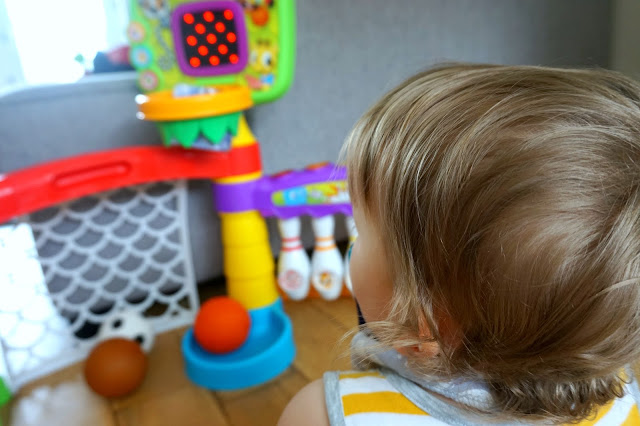boy looking at little tikes light 'n' go 3-in-1 sports zone