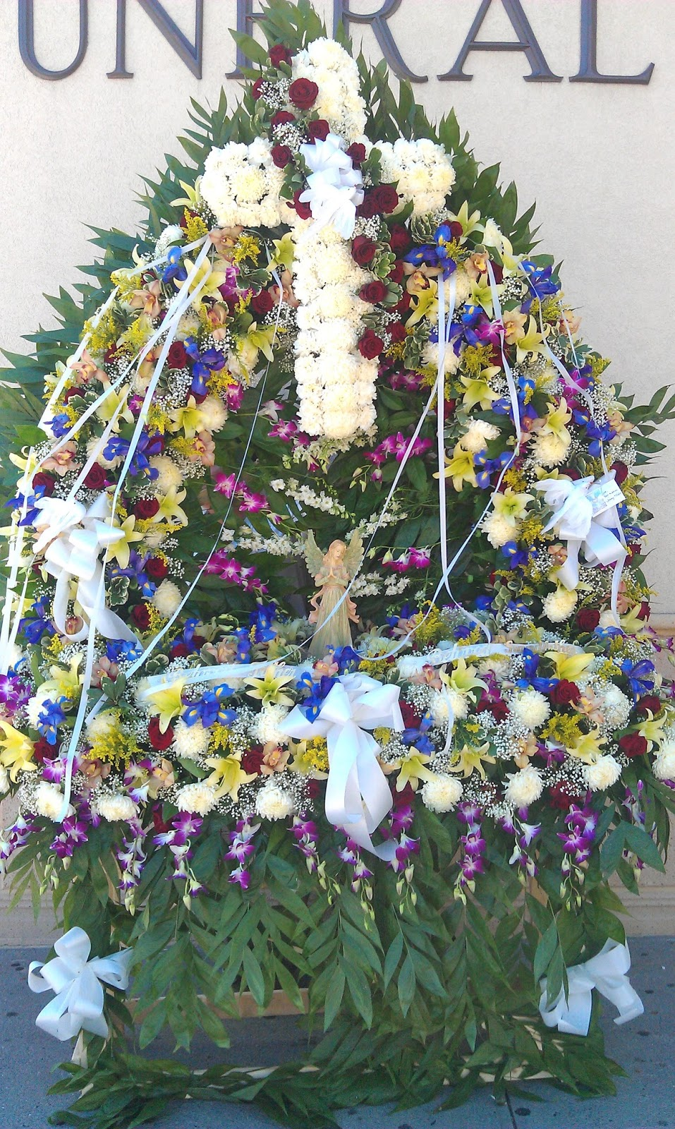 Glendale florist funeral designs the gates of heaven symbolize your loved ones arrival at their final resting place prices starting at 700 and up tax and delivery charges not included izmirmasajfo