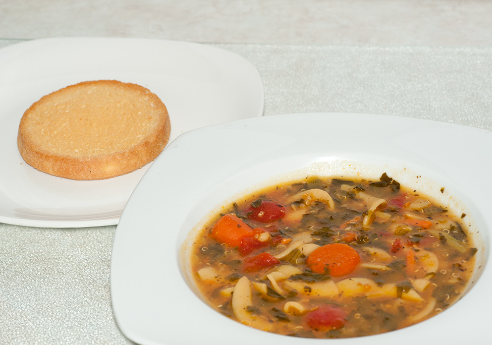A hot bowl of homemade veggie soup pairs nicely with a dutch rusk.