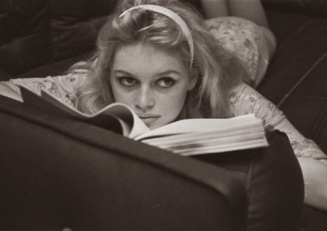 Vintage black and white photo of Brigitte Bardot reading