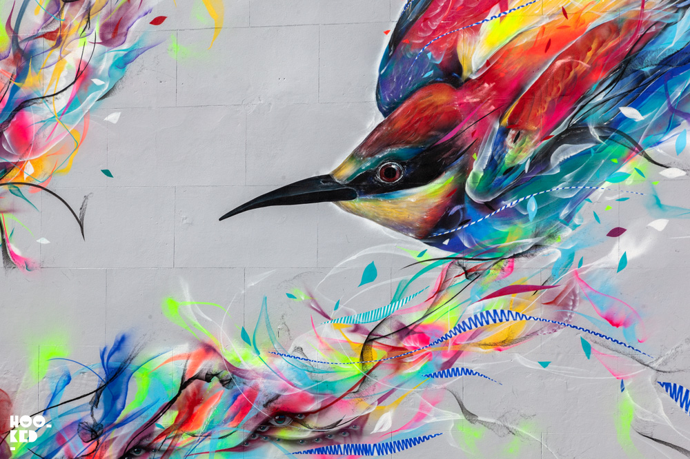Brazilian street artists L7M paints bird mural in Cheltenham, UK