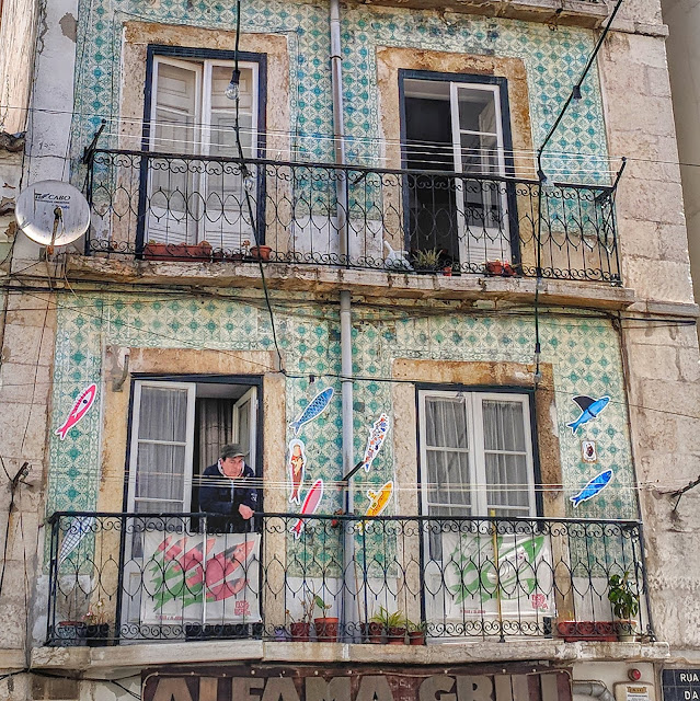 Tile covered building in Lisbon, photo credit: Lindsey Viscomi