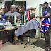 Governor Fayose Pictured Having a Hair cut at Exotic Barbing Salon, Adebayo Road, Ado-Ekit