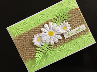 handmade birthday card with paper daisies and embossed background